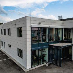 Gewerbe Fassade Metall essl-dach.at Wärmedämung Konstruktion bild